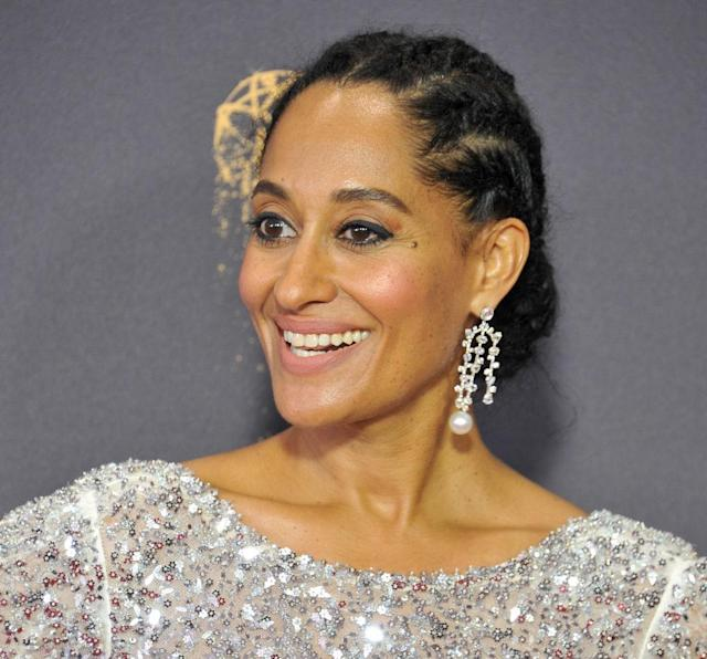 <p>A cornrowed chingnon with droplet earrings is a simple yet chic way to steal the scene at your next holiday party. (Photo: Getty Images) </p>