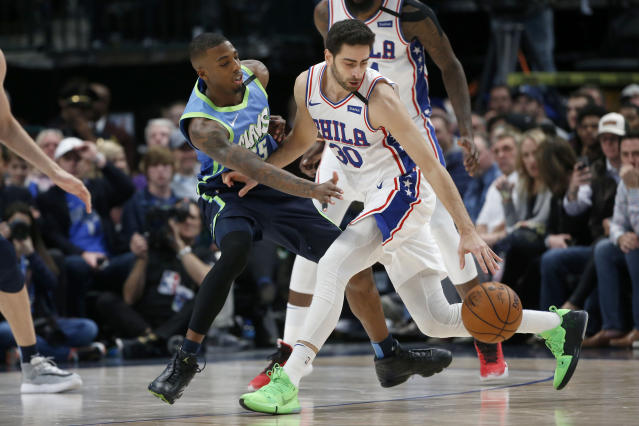 Dallas Mavericks guard Delon Wright (55) defends against Philadelphia 76ers guard Furkan Korkmaz (30) during the second half of an NBA basketball game in Dallas, Saturday, Jan 11, 2020. (AP Photo/Michael Ainsworth)