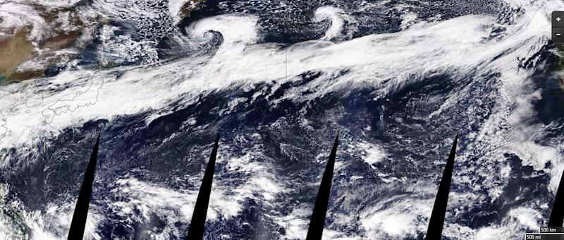 The composite image above, released by NASA, shows a large atmospheric river stretching from China on the left to the coast of North America on the right.