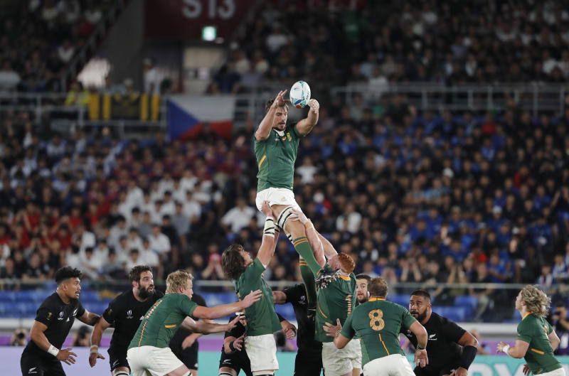 South Africa's Eben Etzebeth reaches for the ball in the air during the Rugby World Cup Pool B game between New Zealand and South Africa in Yokohama, Japan, Saturday, Sept. 21, 2019. (AP Photo/Shuji Kajiyama)