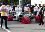 The car of Aston Martin driver Lance Stroll of Canada sits with its wheels wrapped after a crash during the Formula One Grand Prix at the Baku Formula One city circuit in Baku, Azerbaijan, Sunday, June 6, 2021. (Maxim Shemetov, Pool via AP)