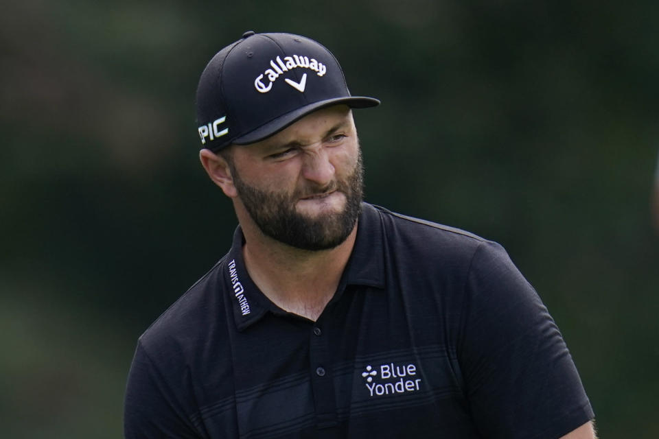 Jon Rahm, of Spain, reacts after putting on the tenth green during the second round of the BMW Championship golf tournament, Friday, Aug. 27, 2021, at Caves Valley Golf Club in Owings Mills, Md. (AP Photo/Julio Cortez)
