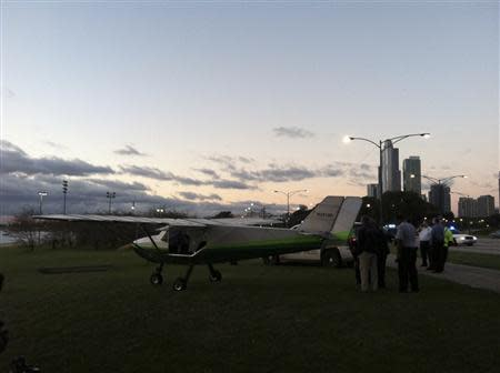 A small plane that was forced to make an emergency landing on Lake Shore Drive in Chicago is pictured in this handout photo taken September 22, 2013, courtesy of the Chicago Sun-Times. REUTERS/Chicago Sun-Times/Ashley Rezin/Handout via Reuters