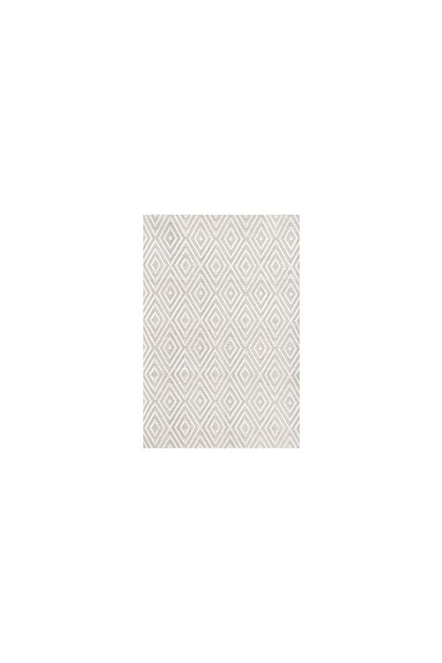 """<p>This neutral diamond rug is the statement piece your kitchen is missing.<br></p><p><em>4'x6', $184, Birch Lane</em><br><em></em><a class=""""body-btn-link"""" href=""""https://go.redirectingat.com?id=74968X1596630&url=https%3A%2F%2Fwww.birchlane.com%2Frugs%2Fpdp%2Fdash-and-albert-rugs-diamond-hand-woven-platinumwhite-indooroutdoor-area-rug-cbgl1045.html%3Fpiid%3D30602155&sref=http%3A%2F%2Fwww.elledecor.com%2Fshopping%2Fhome-accessories%2Fg10268584%2Fkitchen-rugs%2F"""" target=""""_blank"""">Buy Now</a></p>"""