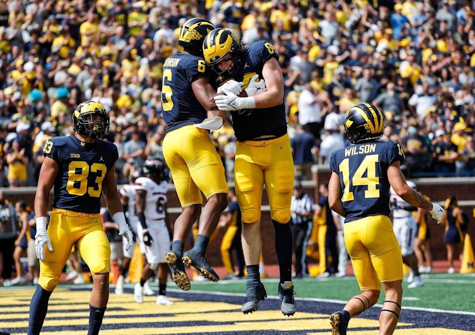 Michigan wide receiver Cornelius Johnson (6) celebrates his touchdown with tight end Joel Honigford (84) s during the first half at Michigan Stadium in Ann Arbor on Saturday, Sept. 18, 2021.