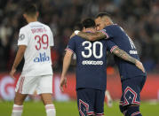 PSG's Neymar, right, celebrates with Lionel Messi after scoring his side's first goal during the French League One soccer match between Paris Saint-Germain and Lyon at the Parc des Princes in Paris Sunday, Sept. 19, 2021. (AP Photo/Francois Mori)