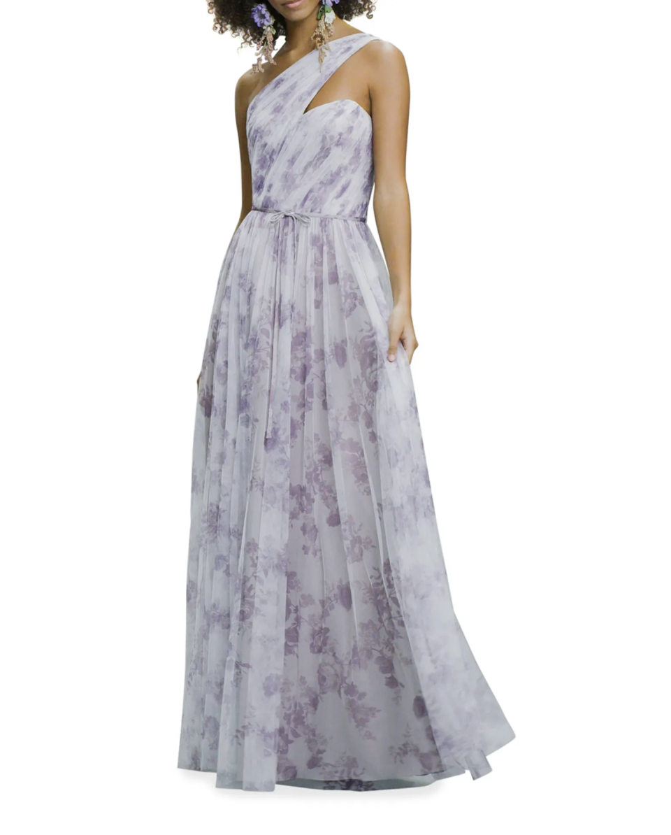 model with afro posing in light purple floral one shoulder gown