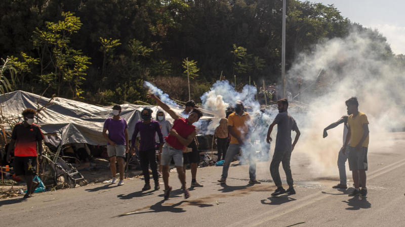 Tear gas fired at migrant protesters on Greek island of Lesbos