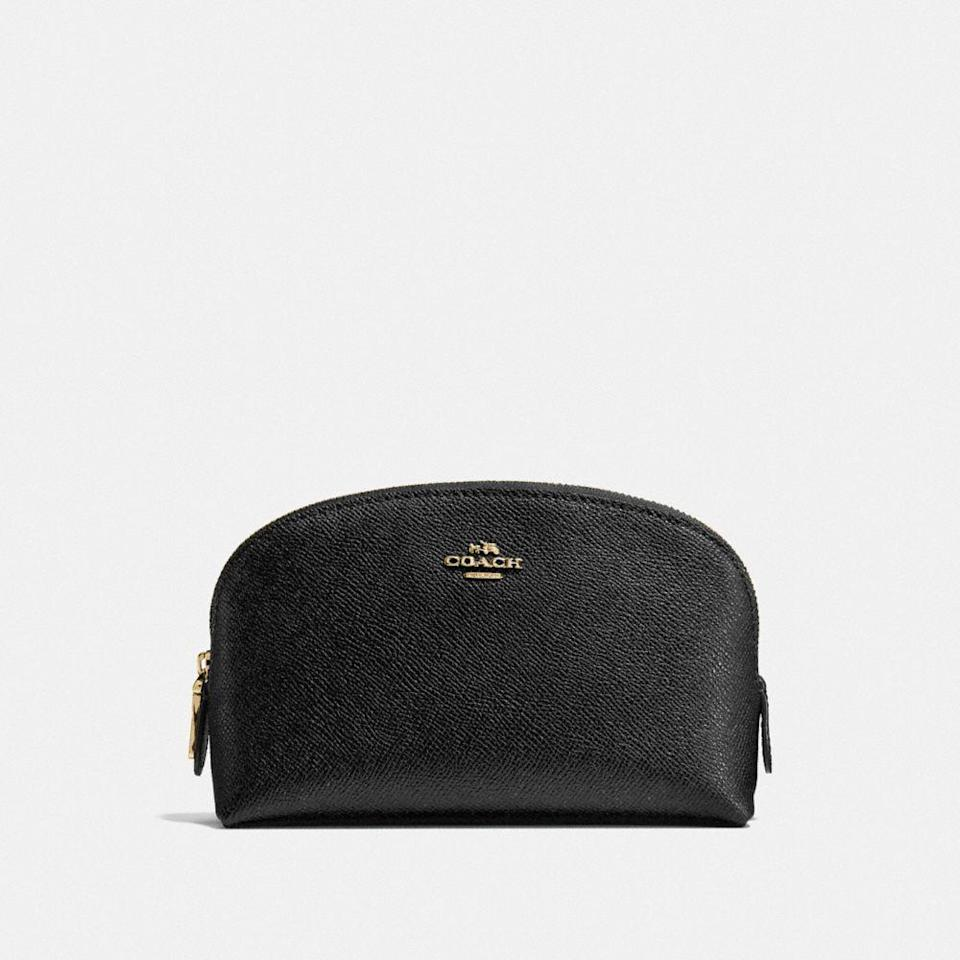 "<p><strong>COACH</strong></p><p>coach.com</p><p><strong>$75.00</strong></p><p><a href=""https://go.redirectingat.com?id=74968X1596630&url=https%3A%2F%2Fwww.coach.com%2Fcoach-cosmetic-case-17%2F57844.html&sref=https%3A%2F%2Fwww.womenshealthmag.com%2Fbeauty%2Fg32771189%2Fbest-makeup-bags%2F"" rel=""nofollow noopener"" target=""_blank"" data-ylk=""slk:Shop Now"" class=""link rapid-noclick-resp"">Shop Now</a></p><p>If you want to splurge without breaking the bank, then you might fall in love with this makeup bag from Coach. It's a must-have basic made from crossgrain leather. The case is pretty compact, so save this one for just the essentials. </p>"