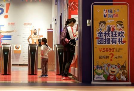 A boy waits to enter the NBA Playzone at a shopping mall in Beijing