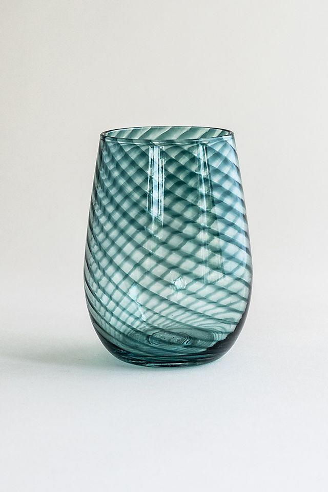 """<h2>Saban Glass Hand Blown Twisty Wine Glass<br></h2><br>She's probably broken a few of her favorite stemmed goblets during quarantine, so surprise her with a sweet new stemless beauty crafted from ethereal hand-blown glass.<br><br><em>Shop <strong><a href=""""https://www.anthropologie.com/shop/saban-glass-hand-blown-twisty-wine-glass"""" rel=""""nofollow noopener"""" target=""""_blank"""" data-ylk=""""slk:Anthropologie"""" class=""""link rapid-noclick-resp"""">Anthropologie</a></strong></em><br><br><strong>Saban Glass</strong> Hand Blown Twisty Wine Glass, $, available at <a href=""""https://go.skimresources.com/?id=30283X879131&url=https%3A%2F%2Fwww.anthropologie.com%2Fshop%2Fsaban-glass-hand-blown-twisty-wine-glass"""" rel=""""nofollow noopener"""" target=""""_blank"""" data-ylk=""""slk:Anthropologie"""" class=""""link rapid-noclick-resp"""">Anthropologie</a>"""