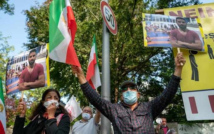 Protests against Navid Afkari's execution at the Iranian embassy in Berlin, Germany - Shutterstock