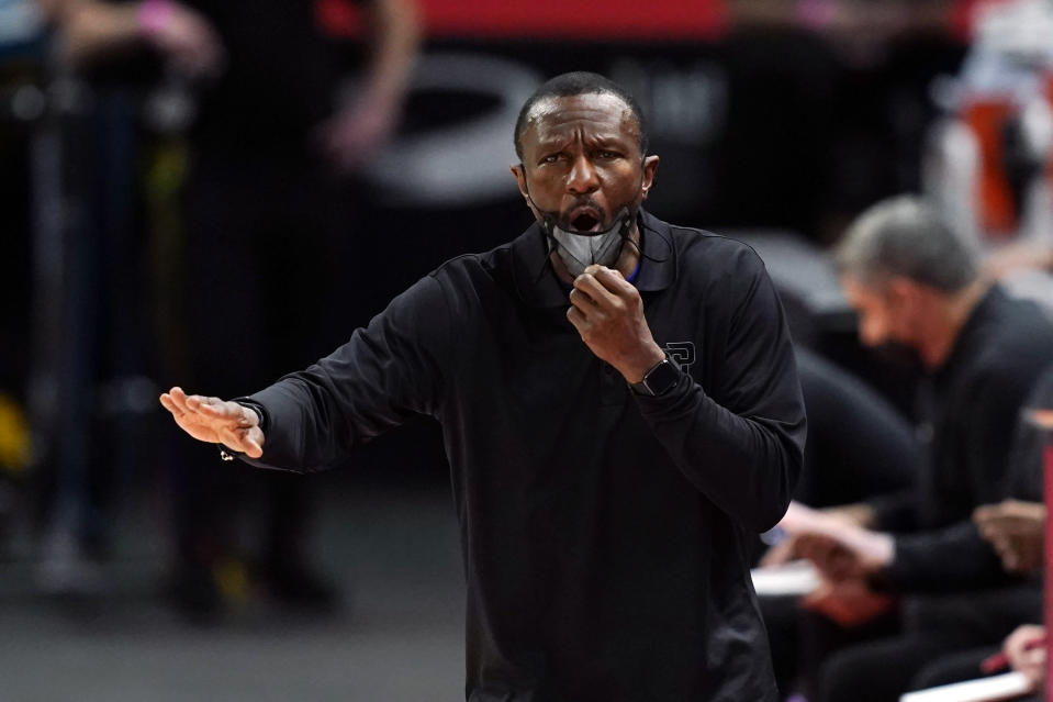Detroit Pistons head coach Dwane Casey yells from the sideline during the first half of an NBA basketball game against the Minnesota Timberwolves, Tuesday, May 11, 2021, in Detroit. (AP Photo/Carlos Osorio)