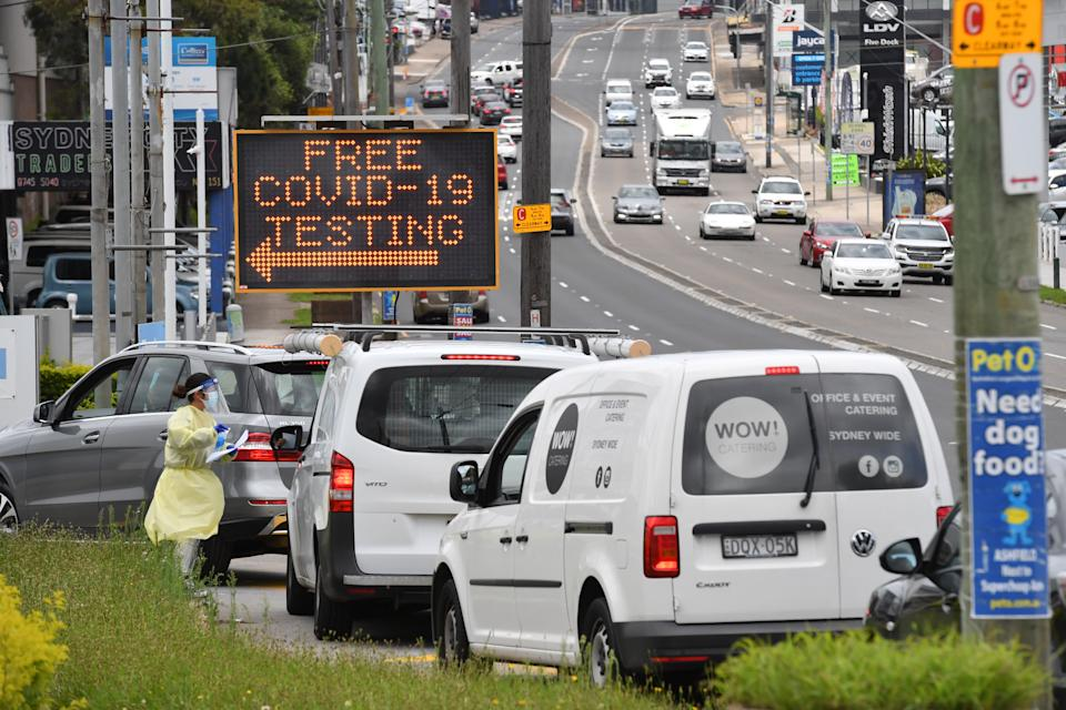 Long lines of cars queue for COVID-19 testing at the inner west suburb of Five Dock, Wednesday, December 30, 2020.