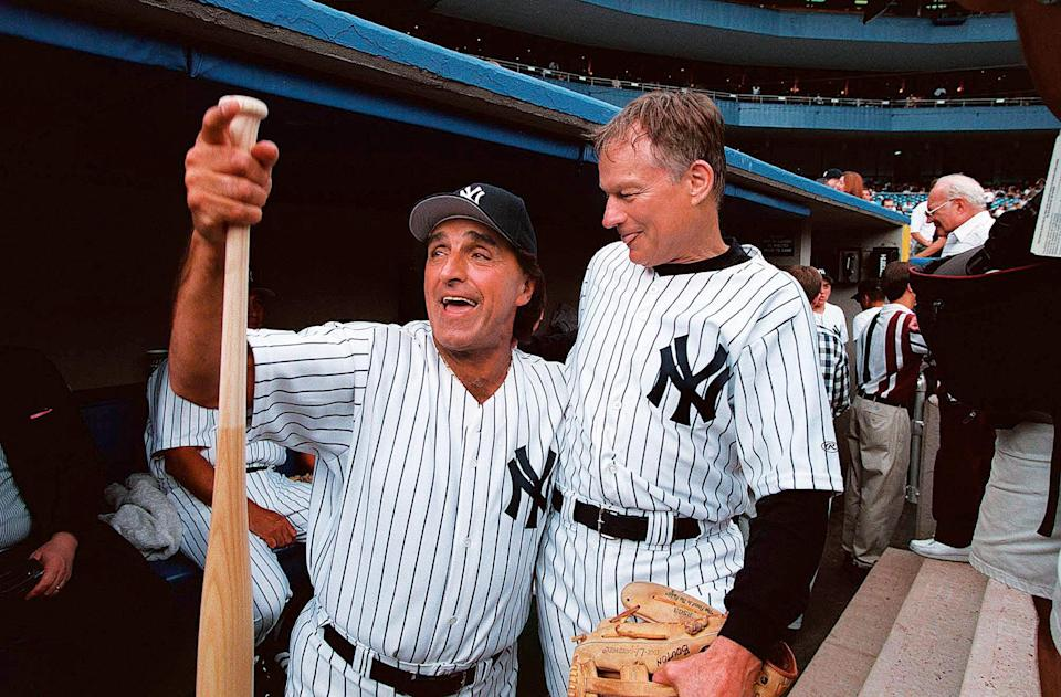 From left, former New York Yankees Joe Pepitone and Jim Bouton share some laughs before action in the Old-Timers' Game against the Los Angeles Dodgers at Yankee Stadium on July 25, 1998.