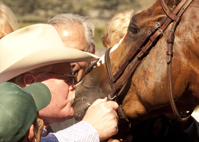 In this image provided by Benoit Photo, co-owner Steve Coburn has a big kiss for his California Chrome following his wire-to-wire for victory in the San Felipe Stakes horse race Saturday, March 8, 2014 at Santa Anita Park in Arcadia, Calif. (AP Photo/Benoit Photo)