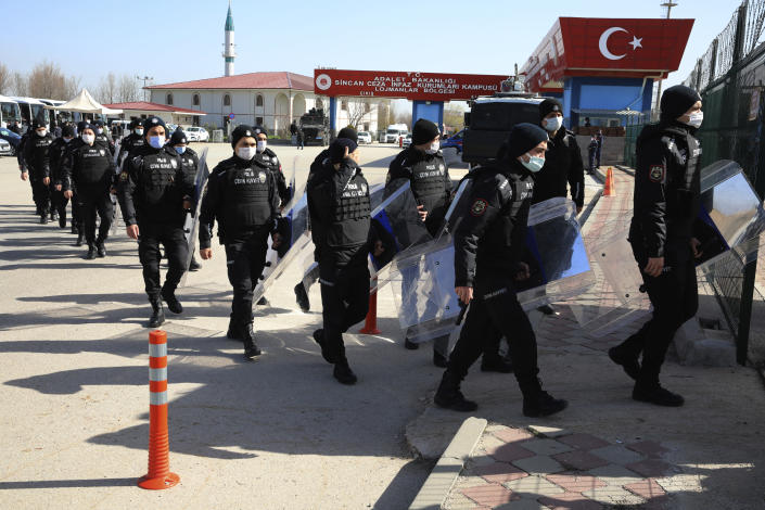 Riot police officers enter courthouse before the trial of 497 defendants, in Sincan, outside the capital Ankara, Turkey, Wednesday, April 7, 2021. The court was expected to deliver a verdict in their trial for involvement in a failed coup attempt in 2026. The court was expected to deliver a verdict in their trial for involvement in a failed coup attempt in 2026.(AP Photo/Burhan Ozbilici)