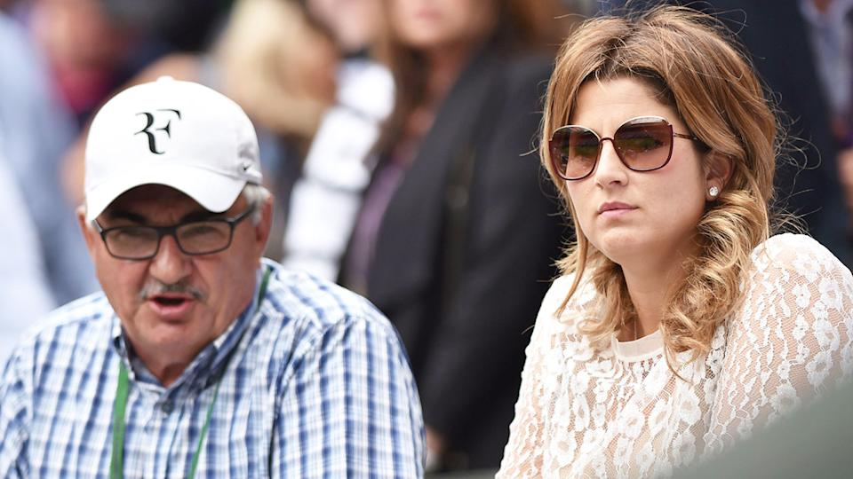 Pictured here, Roger Federer's father Robert watches a match with the tennis player's wife Mirka.