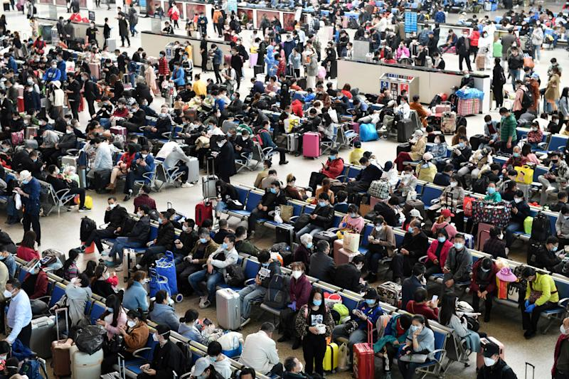 Travellers are seen inside Hankou Railway Station after travel restrictions to leave Wuhan, the capital of Hubei province. Source: Reuters