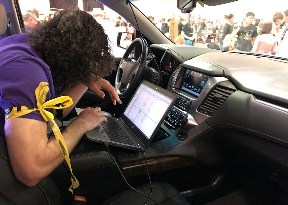An attendee of the 2019 DEF CON cybersecurity event is seen at the conference's car hacking village in Las Vegas, Nevada, U.S., August 9, 2019. Picture taken August 9, 2019. REUTERS/Tina Bellon