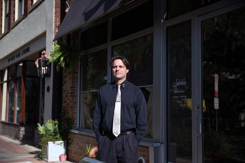 Jason Cooper tried to get jobless benefits for weeks without success before returning to his job at a Florida restaurant this month. (Charlotte Kesl/The New York Times)