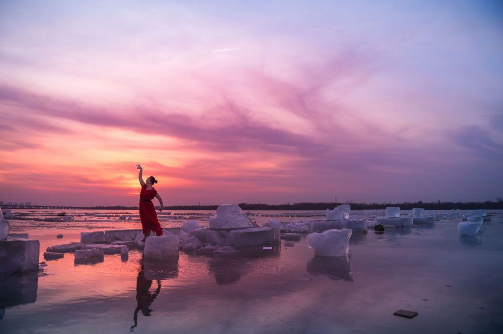 <p>A woman performs a dance of spring standing amid ice and snow on Songhua River in Harbin, Heilongjiang Province, China // February 24, 2019</p>