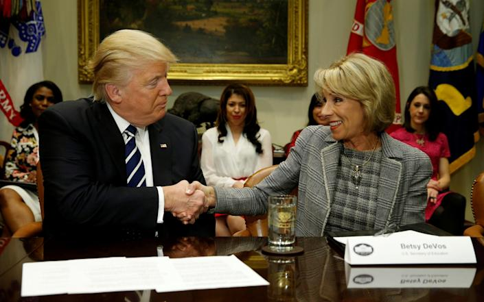 DeVos pointed the finger at Trump over the riots - REUTERS