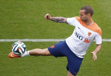 Netherlands' national soccer player Wesley Sneijder kicks the ball during a training session in Rio de Janeiro June 30, 2014, after their 2014 World Cup round of 16 match win against Mexico. REUTERS/Ricardo Moraes