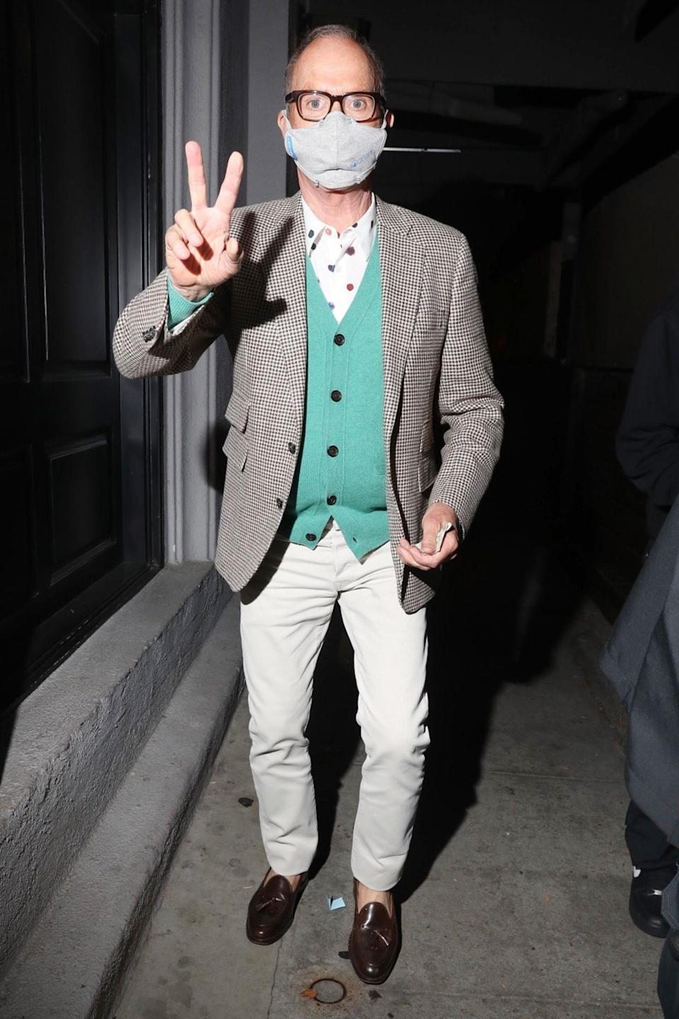 <p>Michael Keaton flashes a peace sign as he's seen leaving dinner at Craig's on Tuesday in L.A.</p>