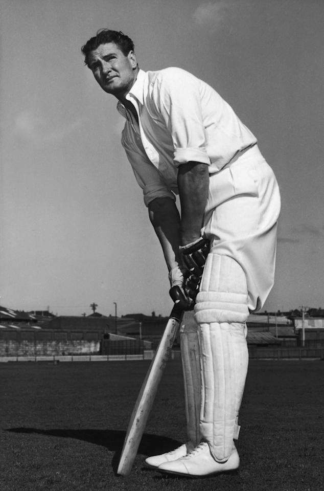 Australian all rounder Keith Ross Miller (1919 - 2004), who played cricket for his country on 55 occasions, served as a fighter pilot and worked as a journalist after retiring from his playing career, 1955. (Photo by Central Press/Getty Images)