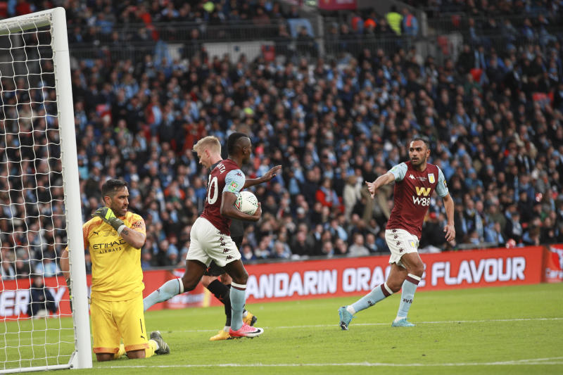 Manchester City's goalkeeper Claudio Bravo reacts as Aston Villa's Mbwana Samatta, center, runs off with the ball after scoring his side's first goal during the League Cup soccer match final between Aston Villa and Manchester City, at Wembley stadium, in London, England, Sunday, March 1, 2020. (AP Photo/Ian Walton)