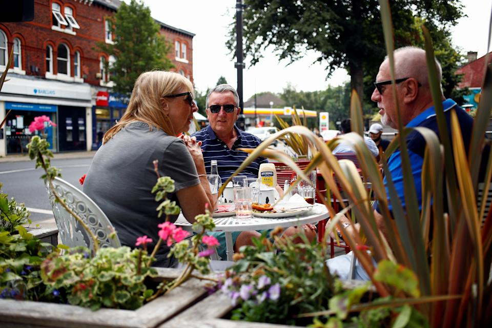 Diners have lunch outside a restaurant in Didsbury, as the 'Eat Out to Help Out' scheme continues, amid the coronavirus disease (COVID-19) outbreak, in Manchester, Britain, August 10, 2020.  REUTERS/Jason Cairnduff