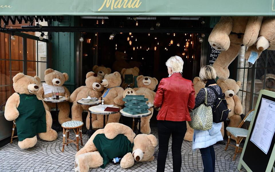 Pictured last month, one Paris restaurant replaced its diners with giant teddybears - Getty