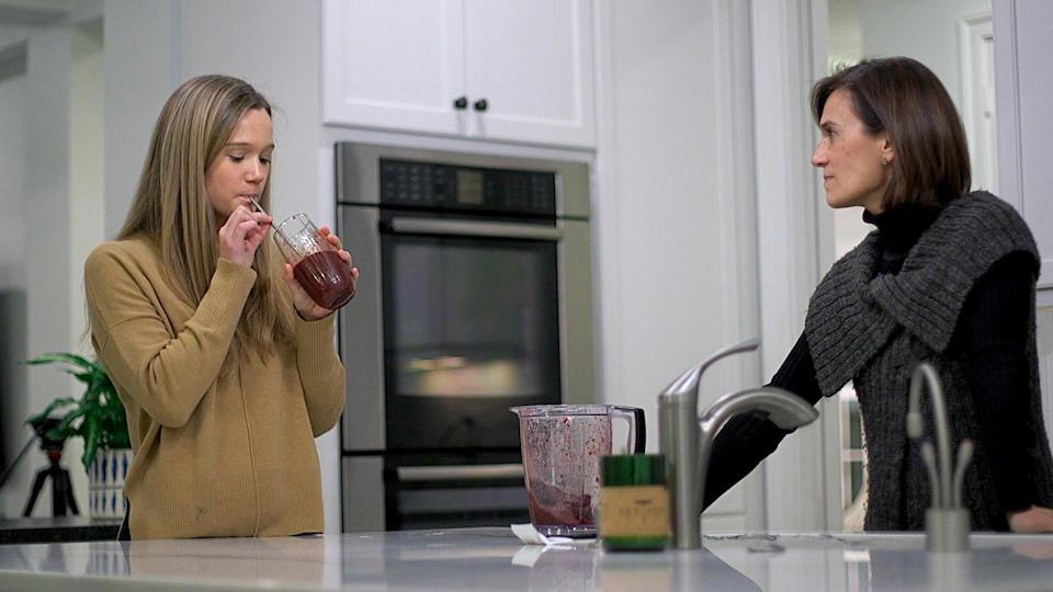 In this Jan. 10, 2020 image from video, 18-year-old Nina Nichols takes her daily dose of Palforzia as her mother, Maria Acebal watches, in her home in Washington. On Friday, Jan. 30, 2020, the Food and Drug Administration approved Palforzia, the first treatment for peanut allergies in a big step toward better care for all kinds of food allergies -- but still a long way from a cure. (AP Photo/Federica Narancio)