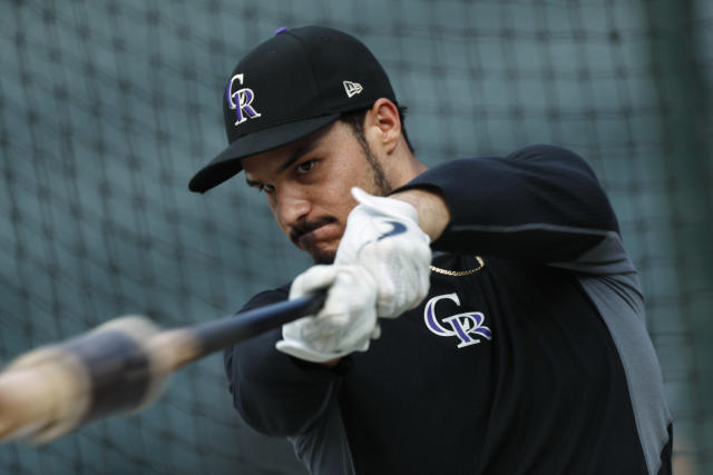 FILE - In this Sept. 27, 2019, file photo, Colorado Rockies third baseman Nolan Arenado warms up before a baseball game against the Milwaukee Brewers in Denver. Rockies star Arenado said he feels disrespected after Colorado general manager Jeff Bridich acknowledged listening to trade offers for the seven-time Gold Glove winner. Bridich told The Denver Post on Monday, Jan. 20, 2020, that he expected Arenado to be Colorado's third baseman this season after discussing potential deals involving the 28-year-old this winter. The five-time All-Star agreed to a $260 million, eight-year contract with the Rockies last February. (AP Photo/David Zalubowski, File)