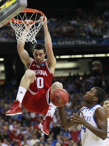 Indiana's Will Sheehey (10) dunks as Kentucky's Michael Kidd-Gilchrist looks on during the first half of an NCAA tournament South Regional semifinal college basketball game Friday, March 23, 2012, in Atlanta. (AP Photo/John Bazemore)