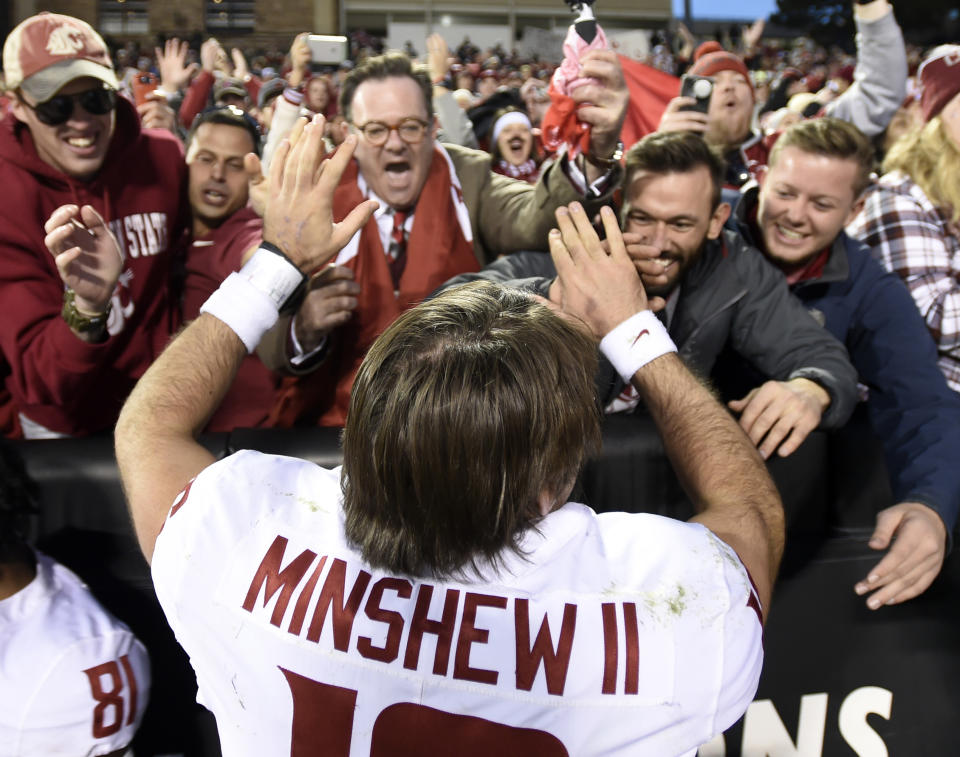 """BOULDER, CO: November 10:Washington State's Gardner Minshew II celebrates with fans after the win over the University of Colorado.""""n(Photo by Cliff Grassmick/Digital First Media Group/Boulder Daily Camera via Getty Images)"""