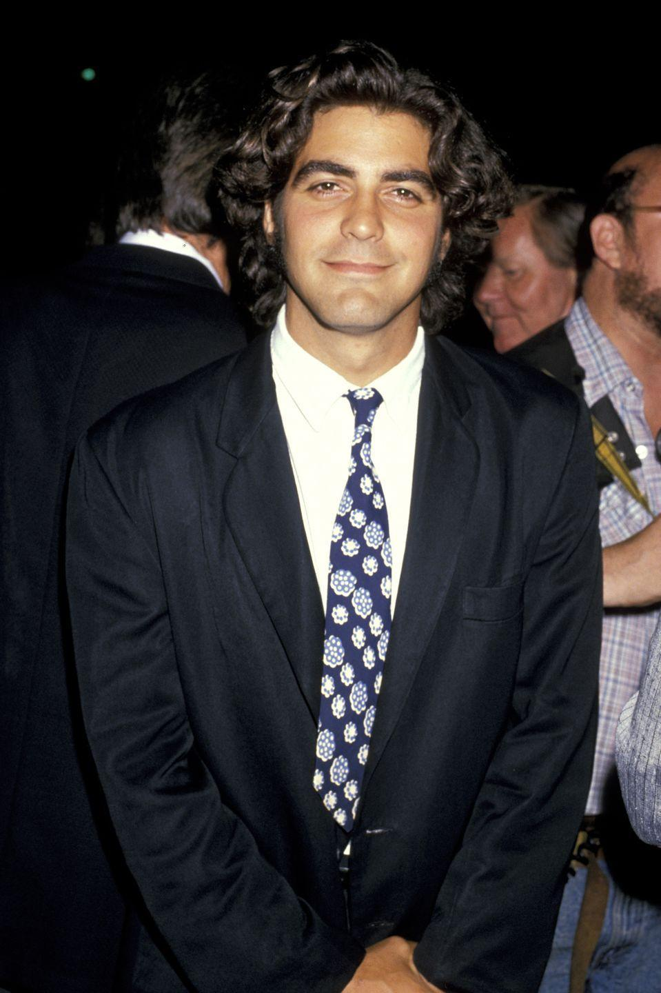 <p>George Clooney in the '80s was all hair. You may be less familiar with this version of the actor, but before <em>ER, </em><em>Ocean's Eleven, </em>and <em>Gravity</em>, he rocked dark brown curls. </p>