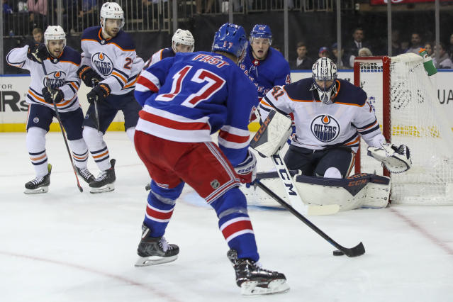 Edmonton Oilers goaltender Mike Smith (41) tends net as New York Rangers right wing Jesper Fast (17) looks for an opening in the second period of an NHL hockey game, Saturday, Oct. 12, 2019, at Madison Square Garden in New York. (AP Photo/Mary Altaffer)