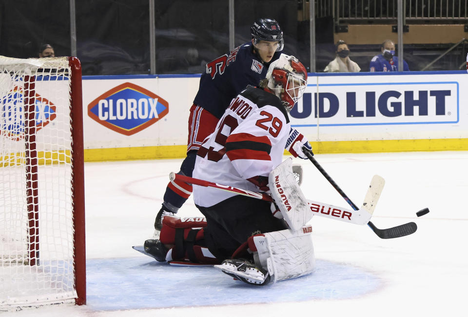 New York Rangers' Ryan Strome (16) attempts to deflect a second-period shot past New Jersey Devils goalie Mackenzie Blackwood (29) during an NHL hockey game Thursday, April 15, 2021, in New York. (Bruce Bennett/Pool Photo via AP)