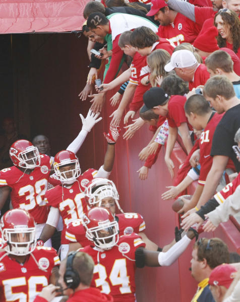 Kansas City Chiefs players greet fans as they exit the tunnel before an NFL football game against the Carolina Panthers at Arrowhead Stadium in Kansas City, Mo., Sunday, Dec. 2, 2012. (AP Photo/Colin E. Braley)