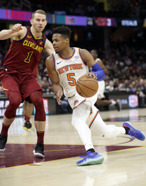 New York Knicks' Dennis Smith Jr. (5) drives past Cleveland Cavaliers' Nik Stauskas (1) in the second half of an NBA basketball game, Monday, Feb. 11, 2019, in Cleveland. The Cavaliers won 107-104. (AP Photo/Tony Dejak)