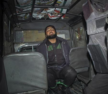 Malik Mumtaz Hussain Qadri, a bodyguard who killed Punjab governor Salman Taseer, is detained at the site of Taseer's shooting in Islamabad, in this January 4, 2011 file picture. REUTERS/Mehdi Shah/Files