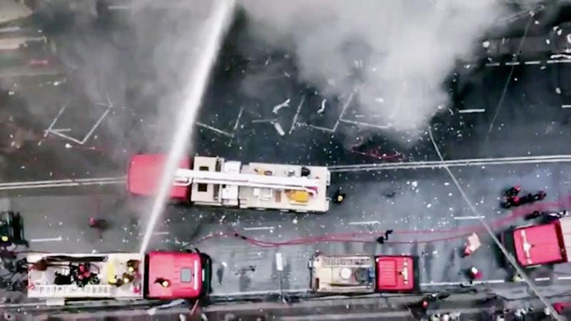 In this image made from video, firetrucks hose down a building on fire in the Banani area of Dhaka, Bangladesh, March 28, 2019. (AP Photo)