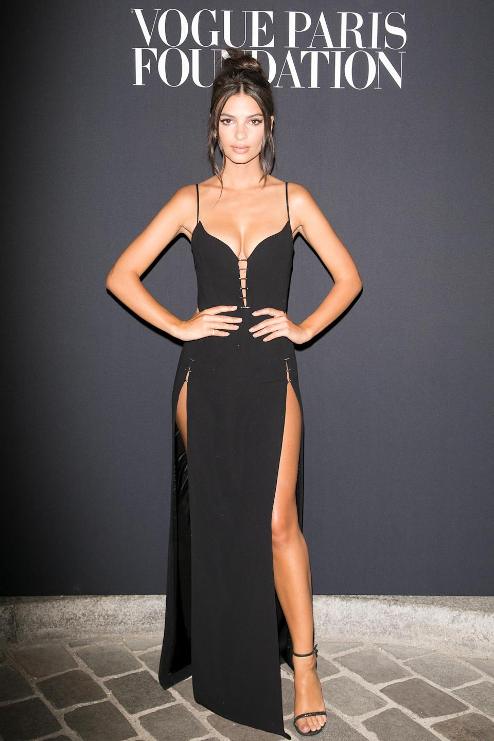 <p>For most of us, a double thigh-split dress has one too many thigh-splits. For Emily, she made her Mugler dress – worn to the Vogue Paris Foundation dinner – look effortless. <br>[Photo: Getty] </p>