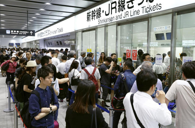 <p>People stand in lines to buy tickets when Shinkansen bullet train service was resumed at Shin-Osaka train station in Osaka, western Japan, Monday, June 18, 2018. (Photo: Meika Fujio/Kyodo News via AP) </p>