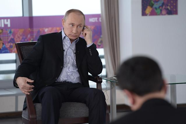 """In this Friday, Jan. 17, 2014 photo made available by Presidential Press Service on Sunday, Jan. 19, 2014, Russian President Vladimir Putin listens to a translation during an interview to Russian and foreign media at the Russian Black Sea resort of Sochi, which will host Winter Olympic Games on Feb. 7, 2014. President Vladimir Putin once again has offered assurances to gays planning to attend the Sochi Olympics, but his arguments defending Russia's ban on homosexual """"propaganda"""" to minors show the vast gulf between how he understands the issues and how homosexuality is generally viewed in the West. In an interview with Russian and foreign television stations broadcast Sunday, Putin equated gays with pedophiles and spoke of the need for Russia to """"cleanse"""" itself of homosexuality as part of efforts to increase the birth rate. (AP Photo/RIA Novosti, Alexei Nikolsky, Presidential Press Service)"""