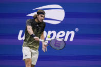Stefanos Tsitsipas, of Greece, returns a shot to Carlos Alcaraz, of Spain, during the third round of the US Open tennis championships, Friday, Sept. 3, 2021, in New York. (AP Photo/Seth Wenig)
