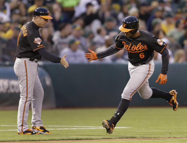 Baltimore Orioles' Jonathan Schoop, right, is congratulated by third base coach Bobby Dickerson after Schoop hit a two-run home run off Oakland Athletics' Jeff Samardzija in the fifth inning of a baseball game Friday, July 18, 2014, in Oakland, Calif. (AP Photo/Ben Margot)