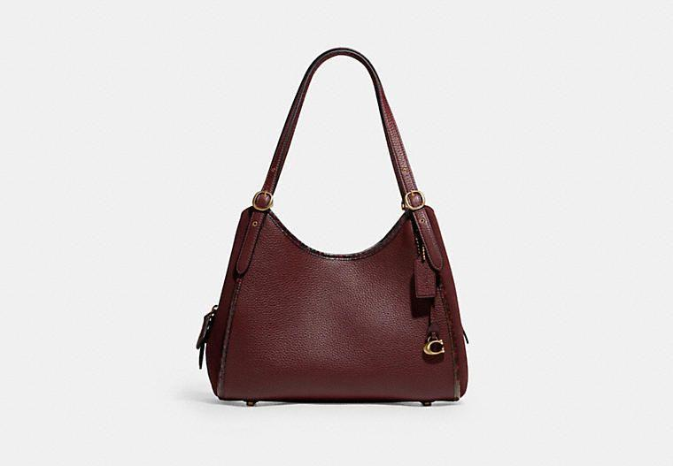 """<p><strong>Coach</strong></p><p>coach.com</p><p><a href=""""https://go.redirectingat.com?id=74968X1596630&url=https%3A%2F%2Fwww.coach.com%2Fproducts%2Flori-shoulder-bag-with-snakeskin-detail%2FC5266.html&sref=https%3A%2F%2Fwww.elle.com%2Ffashion%2Fshopping%2Fg37779639%2Fcoach-sale-bags-2021%2F"""" rel=""""nofollow noopener"""" target=""""_blank"""" data-ylk=""""slk:Shop Now"""" class=""""link rapid-noclick-resp"""">Shop Now</a></p><p><strong><del>$425</del> $318.75 (20% off with code SAVE NOW)</strong></p><p>Our favorite detail on this everyday tote? The subtle hint of snakeskin.</p>"""